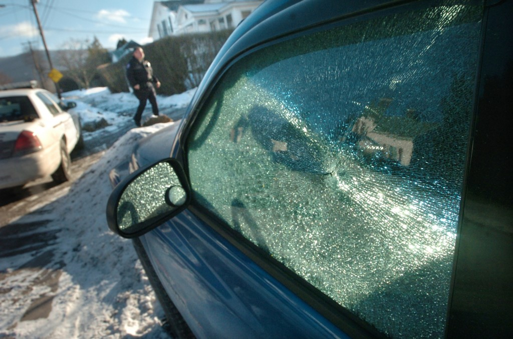 Vyto Starinskas / Staff PhotoOne of the many car windows that were smashed or broken last night in Rutland.